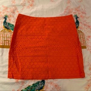 Orange eyelet mini skirt